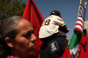 Dominic Ibarra sits on the shoulders of his grandfather Luis Ibarra during an immigration rally on May Day in the Mission District in San Francisco