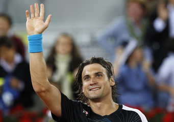 Spain's David Ferrer celebrates his victory over Andy Murray of Britain during the Madrid Open tennis tournament