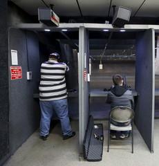 Men target practice with guns at the Ringmasters of Utah gun range