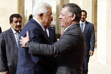 Jordan's King Abdullah welcomes Palestinian President Mahmoud Abbas in Amman