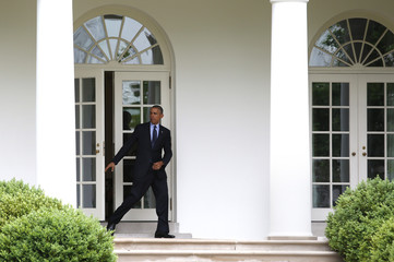 Obama walks from the West Wing of the White House in Washington