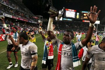 Fiji players celebrate with their trophy after beating New Zealand to win in the final of the Hong Kong Sevens rugby tournament in Hong Kong