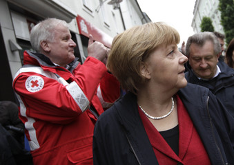 Bavarian federal state premier Seehofer and German Chancellor Merkel tour flooded affected city of  Passau