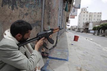A tribesman loyal to tribal leader Sadeq al-Ahmar secures a street near al-Ahmar's house in Sanaa