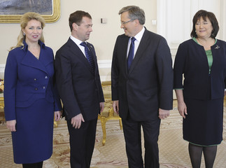 Russian President Medvedev Polish President Komorowski and wives pose for a photo at the Presidential Palace in Warsaw