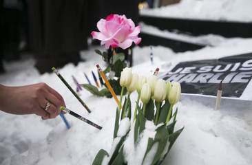 Montrealers place pencils in front of the French Consulate, in tribute to the victims of the shootings by gunmen at the offices of the satirical weekly newspaper Charlie Hebdo in Paris, in downtown Montreal