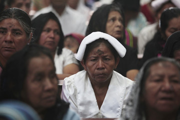 Catholic faithful participate in the traditional Ash Wednesday service, at the Holy Cross parish in Panchimalco