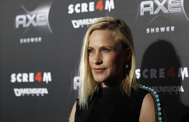 """Arquette poses at the premiere of """"Scream 4"""" at the Grauman's Chinese theatre in Hollywood"""