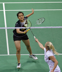 Denmark's Jensen plays a shot against Malaysia's Lim during their women's singles match at the Uber Cup badminton championship in New Delhi