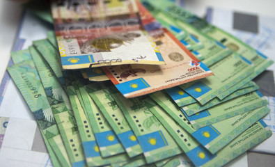 Kazakhstan's Tenge currency notes are seen in a Eurasian Bank branch in Almaty