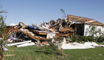A tornado-damaged house is pictured along Route 66 in El Reno