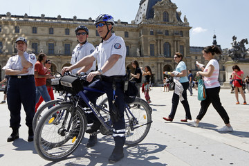 French police patrol on bicycles outside the Louvre museum in Paris