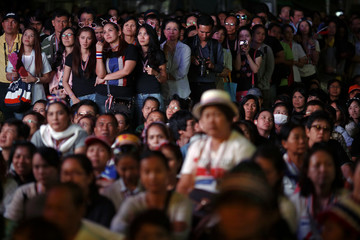 Anti-government protesters listen to protest leader Suthep in central Bangkok
