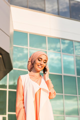 beautiful young arabian woman talking on cell phone