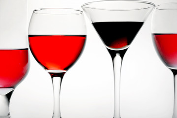four glasses of red wine on it is white background and and place for text background