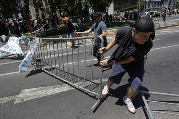 Students block a street during a rally in downtown Santiago