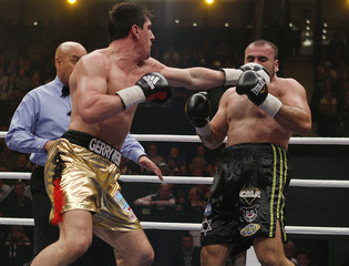 WBO cruiserweight world champion Huck delivers a punch to challenger Nakash during their WBO world championship fight in Halle