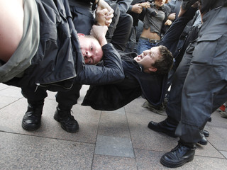 Police officers detain activists during a protest to defend Article 31 of the Russian constitution in St.Petersburg