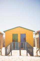 Yellow beach hut on sand
