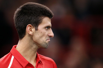 Djokovic of Serbia reacts during his match against Querrey of the US during the Paris Masters tennis tournament in Paris
