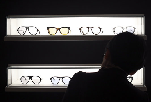 A costumer looks at Tom Ford eyeglasses at the Mido exhibition for glasses and eyewear products in Milan