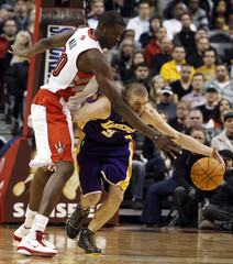 Los Angeles Lakers Blake is fouled by Toronto Raptors Alabi during the first half of their NBA basketball game in Toronto