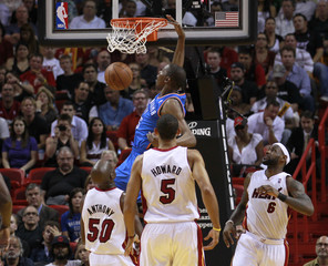 Durant dunks the ball as Miami Heat defenders Joel Anthony, Miami Heat's Juwan Howard and LeBron James look on in the first half during their NBA basketball game in Miami