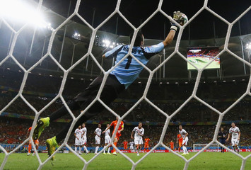 Costa Rica's goalkeeper Navas jumps to save the ball during their 2014 World Cup quarter-finals against the Netherlands at the Fonte Nova arena in Salvador