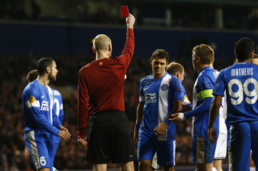Referee Gautier shows a red card to Dnipro's Zozulya during their Europa League soccer match against Tottenham Hotspur at White Hart Lane