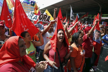 Supporters of deputy candidate of the National Assembly for Venezuela's United Socialist Party  William Ojeda attend a campaign rally in Caracas