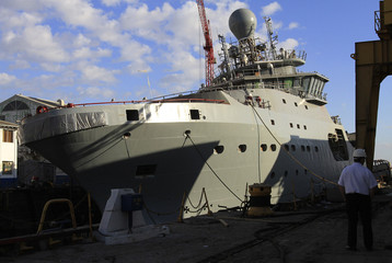 A patrol boat commissioned by the Landhelgisgaeslan sits damaged in a Chilean military shipyard in Talcahuano