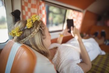 Woman using phone in van