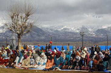 Kashmiri Muslim women perform prayers during festival of Eid-e-Milad in Srinagar