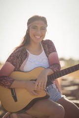 Portrait of smiling woman with guitar