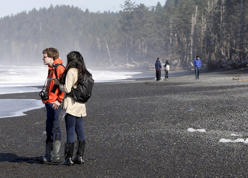 Jimmy Jorgensen and Nikki Mendoza, Marquette University students on spring break, take pictures along the Pacific Ocean at Olympic National Park near Forks, Washington