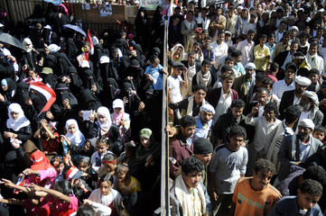 Anti-government protesters, with men and women separated, take part in a rally to celebrate the anniversary of South Yemen's independence from British colonial rule, in Sanaa