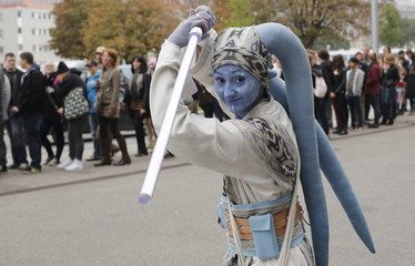 """A woman dressed as a Star Wars character poses at the cartoon fair """"Vienna Comix"""" in Vienna"""