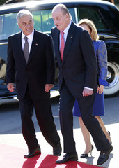 Chile's President Pinera walks next to Spain's King Juan Carlos during their traditional welcome ceremony outside Madrid