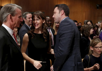 Actor Ben Affleck (C), his wife, actress Jennifer Garner, and their daughter Violet leave after a senate hearing in Washington