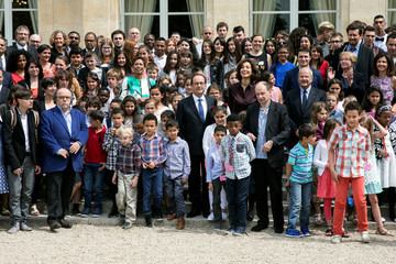 French President Francois Hollande poses with the laureates during the award ceremony for the prix de l'Audace artistique et culturelle at the Elysee Palace in Paris