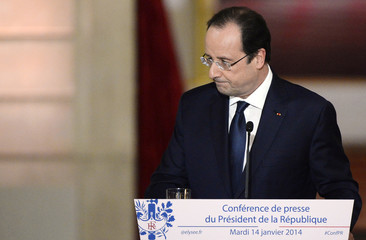 French President Hollande leaves at the end of a news conference at the Elysee Palace in Paris