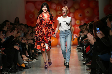 Model Daisy Lowe walks with designer Katie Eary at her catwalk show during London Fashion Week Men's 2017 in London