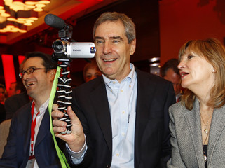 Liberal leader Michael Ignatieff and his wife Zsuzsanna Zsohar look through a video camera at the party conference in Montreal