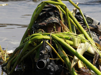 A member of the Philippine Navy Seals is camouflaged by plants during training at the Philippine Navy headquarters in Sangley Point, Cavite city
