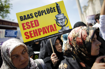 Demonstrators attend a protest against Syria's President Bashar al-Assad at the courtyard of Fatih mosque in Istanbul