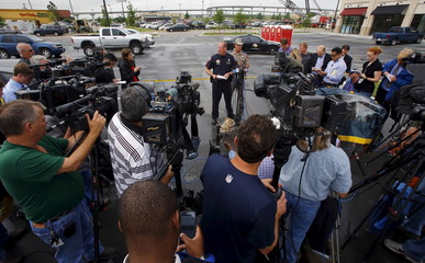 Swanton of the Waco Police Department speaks to the media near a Twin Peaks restaurant where nine members of a motorcycle gang were shot and killed in Waco