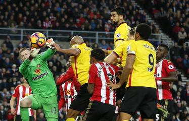 Watford's Miguel Britos heads at goal