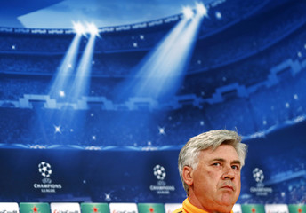 Real Madrid coach Carlo Ancelotti pauses during a news conference in Munich