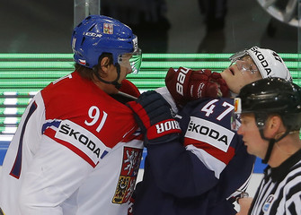 Erat of the Czech Republic scuffles with Krug of the U.S. during their Ice Hockey World Championship third-place game at the O2 arena in Prague