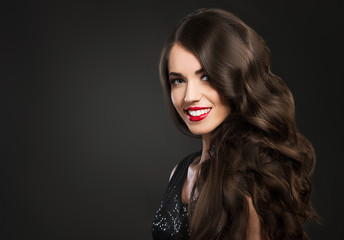 Beautiful woman smiling, glamour portrait on dark background